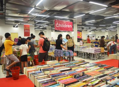 Parents handpicking books for their kids