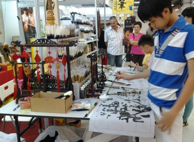 The younger generation learning about calligraphy culture